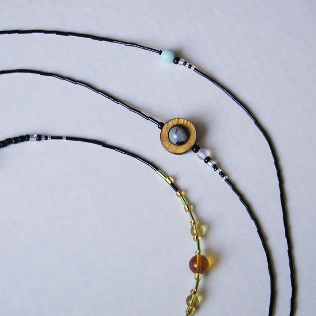 Solar System Necklace measuring the proportional distance between planets - by Laura Cesari